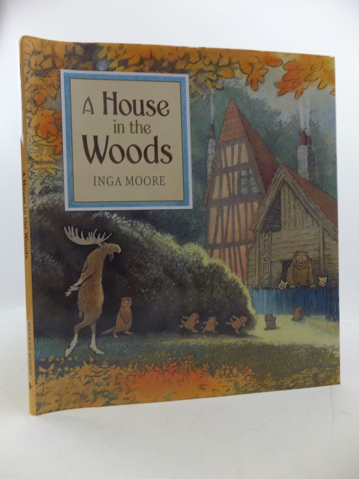 Photo of A HOUSE IN THE WOODS written by Moore, Inga illustrated by Moore, Inga published by Walker Books (STOCK CODE: 1808273)  for sale by Stella & Rose's Books