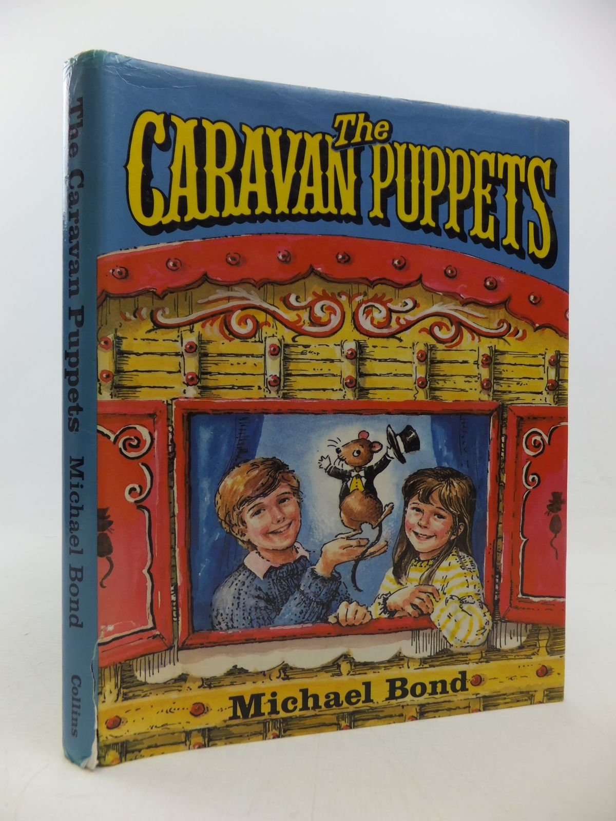 Photo of THE CARAVAN PUPPETS written by Bond, Michael illustrated by Julian-Ottie, Vanessa published by Collins (STOCK CODE: 2113109)  for sale by Stella & Rose's Books