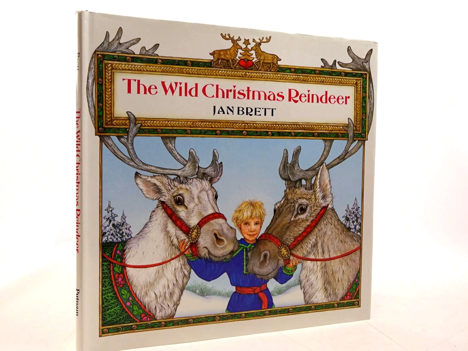 Photo of THE WILD CHRISTMAS REINDEER written by Brett, Jan illustrated by Brett, Jan published by G.P. Putnam's Sons (STOCK CODE: 2130801)  for sale by Stella & Rose's Books