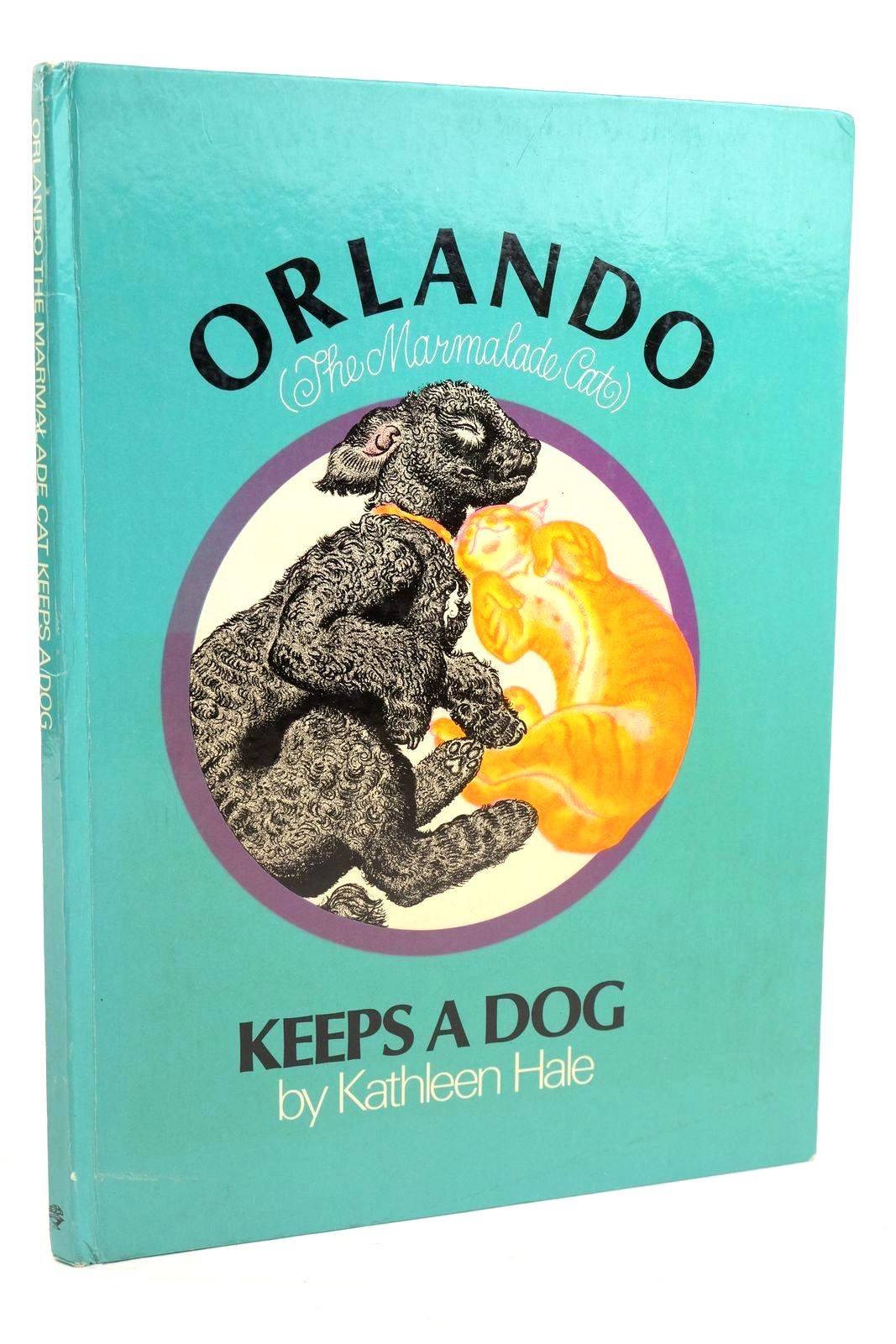 Photo of ORLANDO (THE MARMALADE CAT) KEEPS A DOG- Stock Number: 1319979