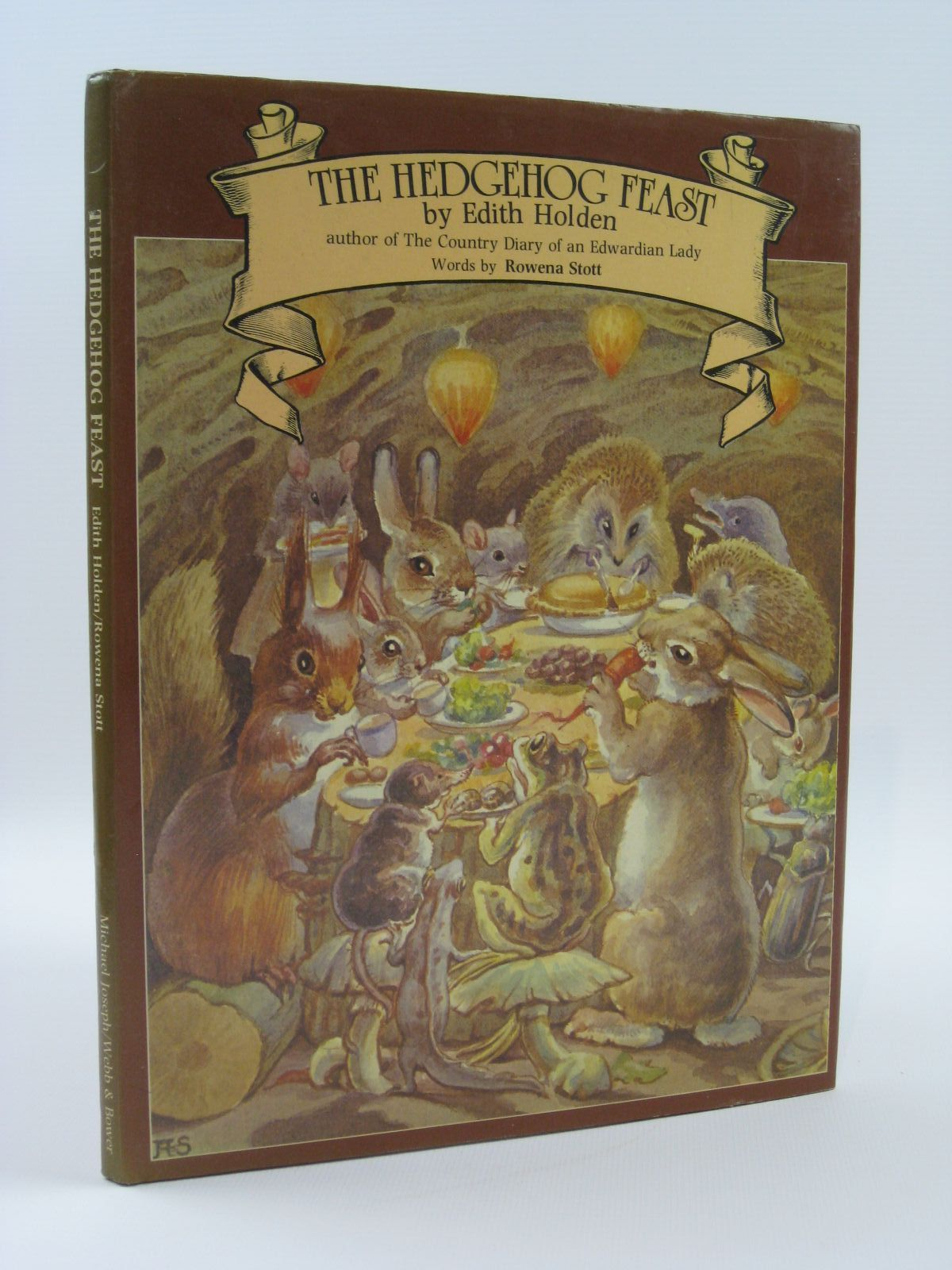 Photo of THE HEDGEHOG FEAST written by Stott, Rowena illustrated by Holden, Edith published by Michael Joseph, Webb & Bower (STOCK CODE: 1507571)  for sale by Stella & Rose's Books