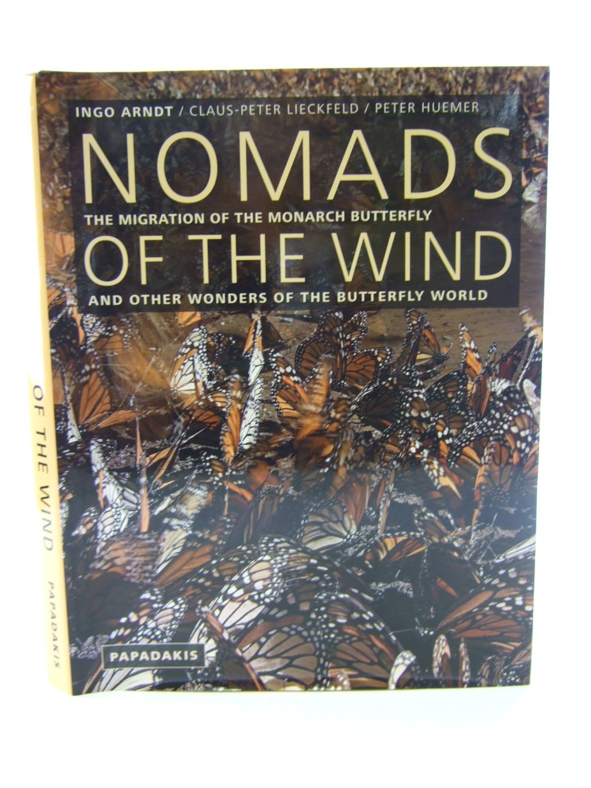 Photo of NOMADS OF THE WIND THE MIGRATION OF THE MONARCH BUTTERFLY AND OTHER WONDERS OF THE BUTTERFLY WORLD written by Arndt, Ingo<br />Lieckfeld, Claus-Peter<br />Huemer, Peter published by Papadakis (STOCK CODE: 1805386)  for sale by Stella & Rose's Books