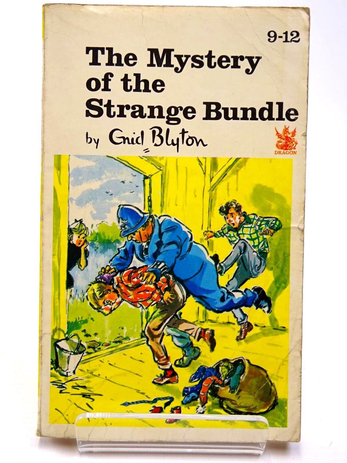Photo of THE MYSTERY OF THE STRANGE BUNDLE written by Blyton, Enid illustrated by Gernat, Mary Chapple, Jenny published by Dragon (STOCK CODE: 2130555)  for sale by Stella & Rose's Books