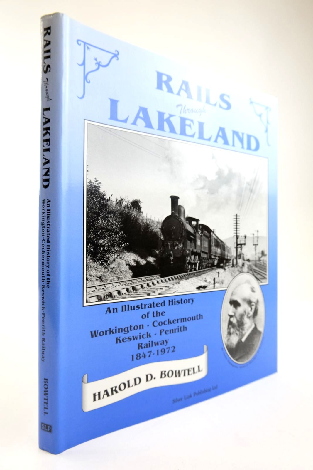 Photo of RAILS THROUGH LAKELAND AN ILLUSTRATED HISTORY OF THE WORKINGTON-COCKERMOUTH-KESWICK-PENRITH RAILWAY 1847-1972- Stock Number: 2133827