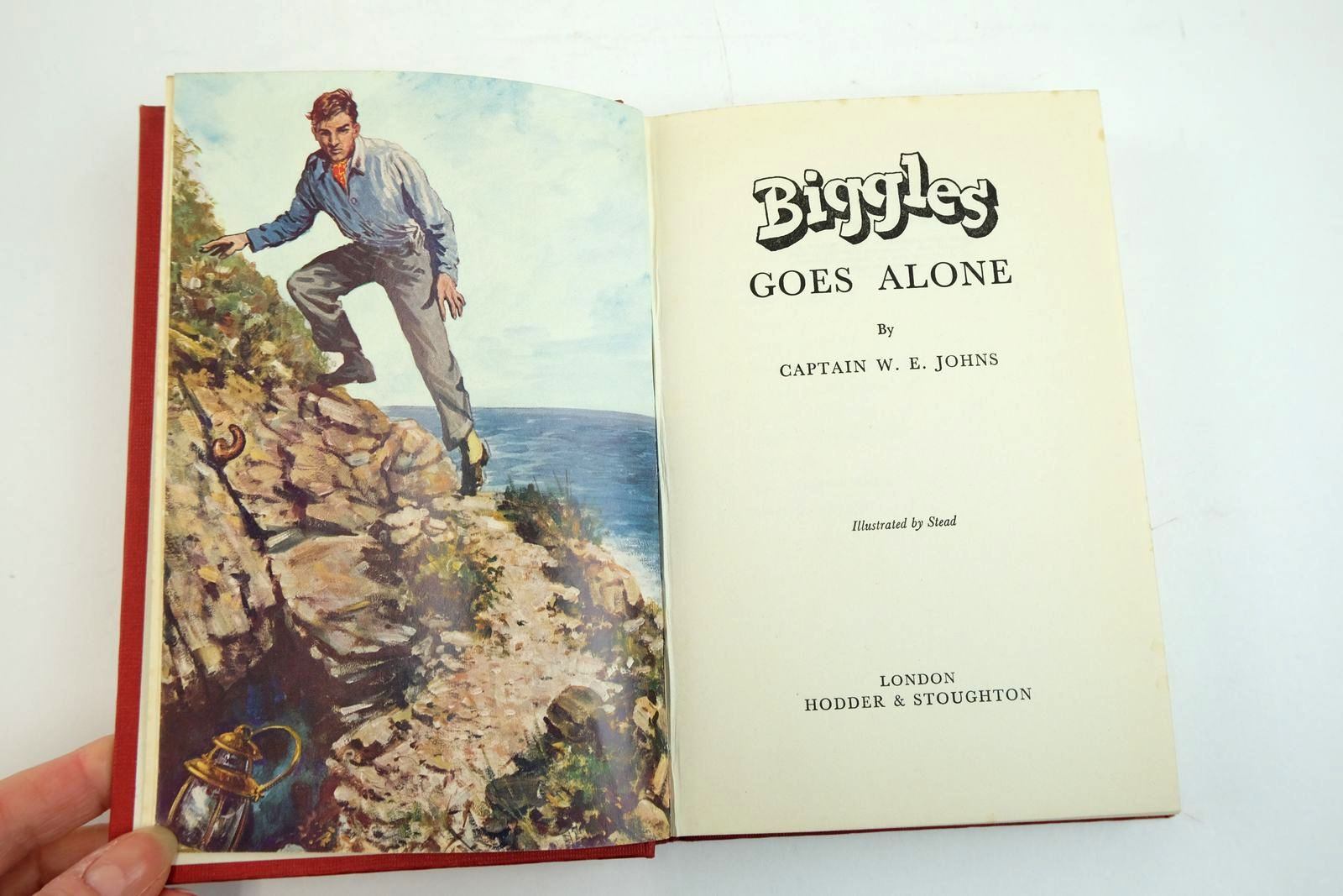Photo of BIGGLES GOES ALONE written by Johns, W.E. illustrated by Stead,  published by Hodder & Stoughton (STOCK CODE: 2134083)  for sale by Stella & Rose's Books