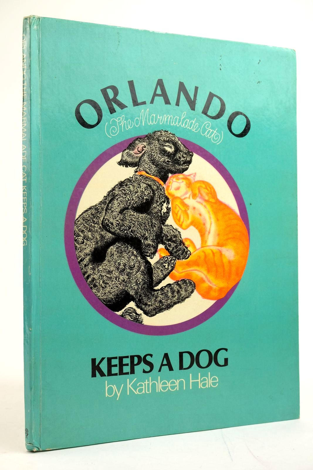 Photo of ORLANDO (THE MARMALADE CAT) KEEPS A DOG- Stock Number: 2135101